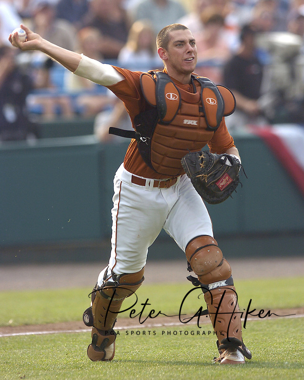 Texas catcher Taylor Teagarden throws to first base to get the Florida runner in the bottom of the second inning.  Texas defeated Florida 4-2 in game one of the Championship Series of the College World Series at Rosenblatt Stadium in Omaha, Nebraska on June 25, 2005.