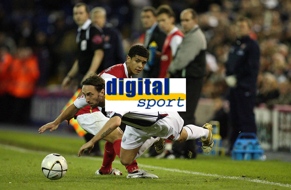 Photo: Rich Eaton.<br /> <br /> West Bromwich Albion v Arsenal. Carling Cup. 24/10/2006. West Broms Jonathan Greening falls after a tackle by Denilson