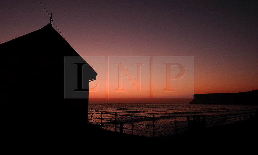 © Licensed to London News Pictures. <br /> 09/05/2016. <br /> Saltburn by the Sea, UK.  <br /> <br /> The first light of dawn stretches over the pier buildings and Huntcliff at Saltburn by the Sea in North Yorkshire. After the warmest day of the year yesterday temperatures are due to drop slowly over the rest of the week.<br /> <br /> Photo credit: Ian Forsyth/LNP