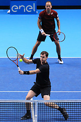 Great Britain's Jamie Murray (front) and Brazil's Bruno Soares (back) during day five of the Barclays ATP World Tour Finals at The O2, London.