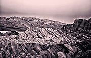 Sunrise on Manly Beacon from Zabriskie Point in Death Valley National Park in California. Copper Tint.