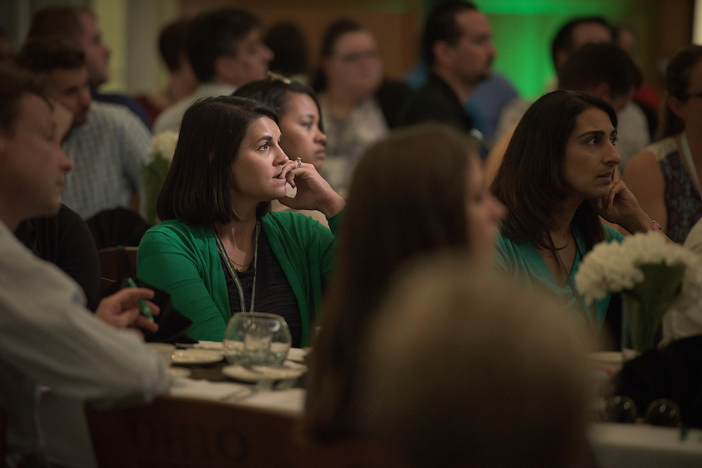 Stephanie Kalch listens to Tom Marchese, Executive-in-Residence and Assiciate Director of the Ohio University College of Business Honors Program, as he speaks with attendees of the Ohio MBA Leadership Development Workshop at the Walter Rotunda in Athens, Ohio on Saturday, August 27, 2016.