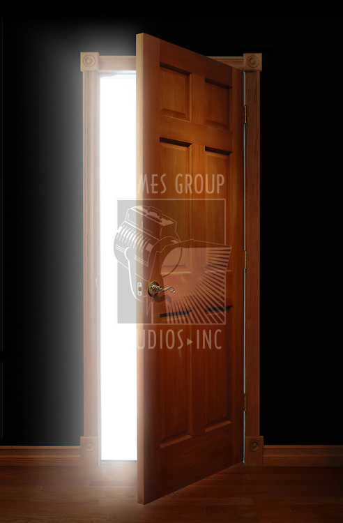 Door opening with bright light illuminating a dark space