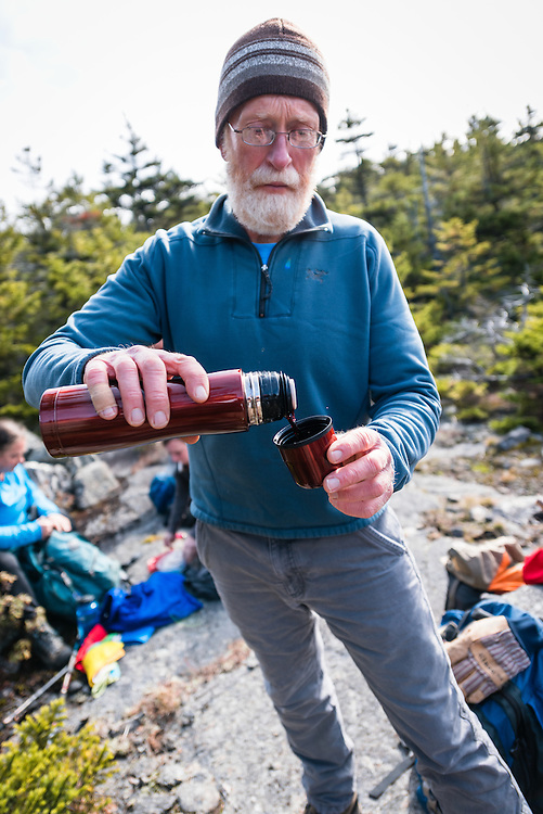 Dave pouring adult grape juice out on the mountain, NH
