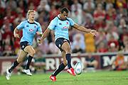 Kurtley Beale kicking. Queensland Reds v NSW Waratahs. Investec Super Rugby Round 10 Match, 24 April 2011. Suncorp Stadium, Brisbane, Australia. Reds won 19-15. Photo: Clay Cross / photosport.co.nz