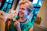 "07 NOVEMBER 2012 - BANGKOK, THAILAND: KRISTIE KENNEY, the US Ambassador to Thailand, wearing an ""Election 2012"" button at the Embassy's election watching party in Bangkok. US President Barack Obama won a second term Tuesday when he defeated Republican Mitt Romney. Preliminary tallies gave the President more than 300 electoral votes, well over the 270 needed to win. The election in the United States was closely watched in Thailand, which historically has very close ties with the United States. The American Embassy in Bangkok sponsored an election watching event which drew thousands to a downtown Bangkok hotel. American Democrats in Bangkok had their own election watch party at a restaurant in Bangkok.       PHOTO BY JACK KURTZ"
