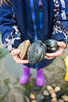 Family holding cockles in Garabaldi, OR.