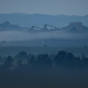 September 17, 2009. Hindman, Kentucky. A coal tipple rises out of the pre-dawn fog at a surface coal mine. (Credit image: © David Stephenson/ZUMA Press)