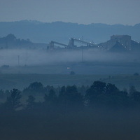 September 17, 2009. Hindman, Kentucky. A coal tipple rises out of the pre-dawn fog at a surface coal mine. (Credit image: © David Stephenson/ZUMA Press)