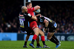 Owen Farrell of Saracens is tackled by Olly Woodburn of Exeter Chiefs and Stuart Hogg of Exeter Chiefs - Mandatory by-line: Ryan Hiscott/JMP - 29/12/2019 - RUGBY - Sandy Park - Exeter, England - Exeter Chiefs v Saracens - Gallagher Premiership Rugby
