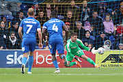 AFC Wimbledon goalkeeper Joe McDonnell (24) saving penalty during the EFL Sky Bet League 1 match between AFC Wimbledon and Luton Town at the Cherry Red Records Stadium, Kingston, England on 27 October 2018.