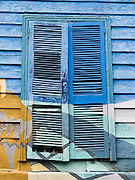 "Louvered window shutters are painted blue and green in San Telmo barrio, the heart of old Buenos Aires, Argentina, South America. Admire well-preserved buildings in San Telmo (""Saint Pedro González Telmo""), the oldest barrio (neighborhood) of Buenos Aires, in Argentina, South America."