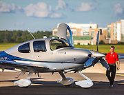 Pre-flight inspection of a Cirrus SR22T, on the ramp at Atlanta's Dekalb Peachtree Airport (PDK).  <br />