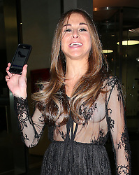Nikki Grahame lost her shoe the night before at Little Mix 'Black Magic' Party. The Big Brother star notice the shoe was found and put on Ebay and shows it on her mobile as she leaves the CharityStars #AGOODSUMMERPARTY held at the Sanctum Soho Hotel in London, UK. 21/07/2015<br />