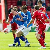 Aberdeen v St Johnstone... 23.07.11   SPL Week 1<br /> David Robertson and Cillian Sheridan block Andrew Considine and Richie Foster<br /> Picture by Graeme Hart.<br /> Copyright Perthshire Picture Agency<br /> Tel: 01738 623350  Mobile: 07990 594431