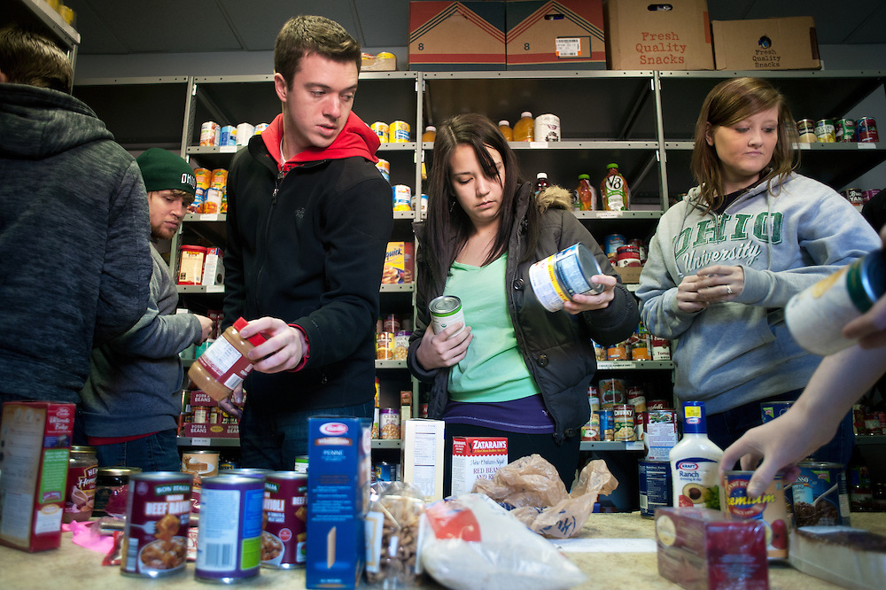 From left to right: Kyle West, Stephan Gable, Kelsey Smith adn Erica Ardrey sort cans of food during the Alpha Beta Psi food drive on February 23rd, 2012. Photo by: Ross Brinkerhoff.