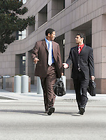 Two business men walking on city street
