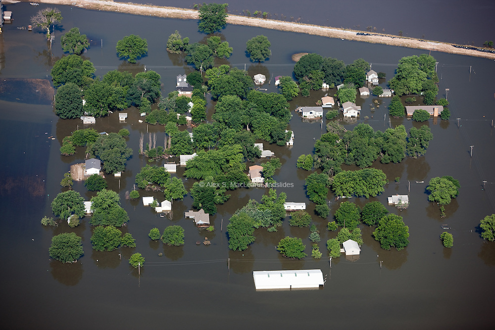 Flood of the upper Mississippi River in June 2008; the flood resulted in thousands of dollars of damage, leaving mold and debris in almost every home and business.