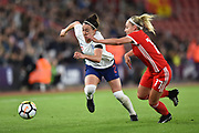 Lucia Bronze (2) of England battles for possession with Charlotte Estcourt (17) of Wales during the FIFA Women's World Cup UEFA Qualifier match between England Ladies and Wales Women at the St Mary's Stadium, Southampton, England on 6 April 2018. Picture by Graham Hunt.
