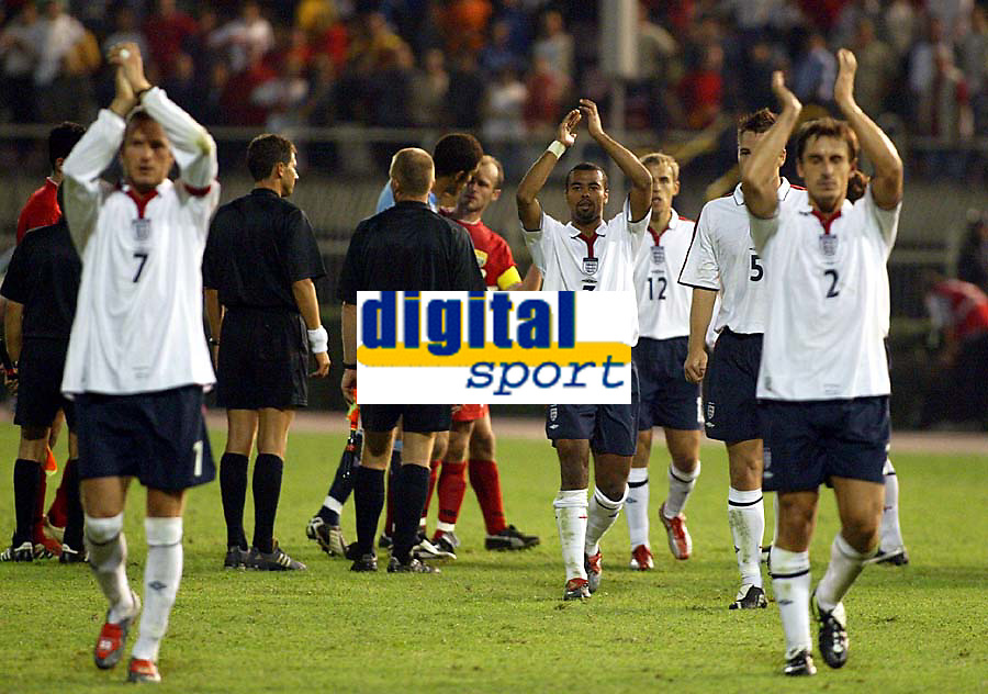 Photograph: Scott Heavey.<br />England v Macadonia at the City Stadium in Skopje, Macadonia. 05/09/2003.<br />The England team applaud the travelling fans.