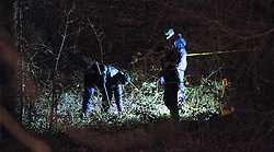 © Licensed to London News Pictures. 15/02/2012. Stockport, UK. Human remains have been found underneath a motorway flyover in Stockport. The site, which is underneath the M60 motorway near junction 3, has been sealed off while police and forensic examiners work at the scene. Photo credit : Joel Goodman/LNP