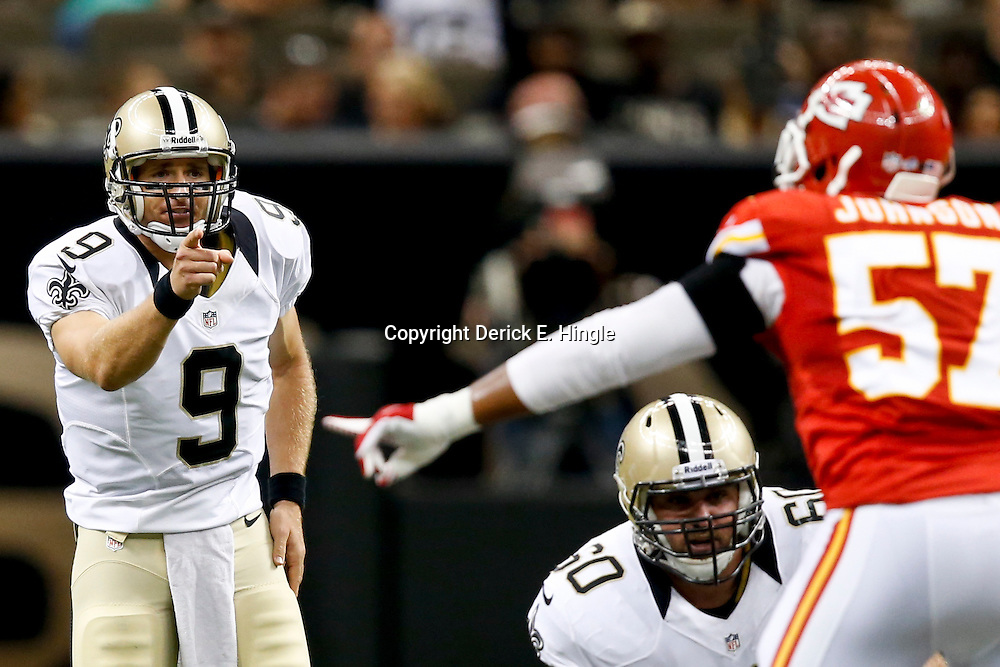 Aug 9, 2013; New Orleans, LA, USA; New Orleans Saints quarterback Drew Brees (9) against the Kansas City Chiefs during the first half of a preseason game at the Mercedes-Benz Superdome. The Saints defeated the Chiefs 17-13. Mandatory Credit: Derick E. Hingle-USA TODAY Sports