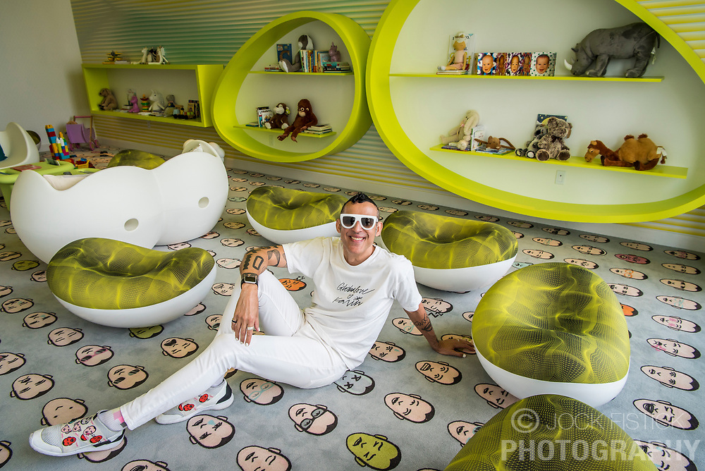 "Karim Rashid designed the interior spaces at Paraiso Bayviews, including the children's play room, where the carpet and his shoes bare his likeness. Time magazine described him as the ""most famous industrial designer in all the Americas"" and the ""Prince of Plastic""."