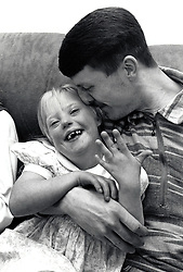 Father & daughter who has Down's Syndrome, UK 1995. MR