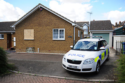 © Licensed to London News Pictures. 31/07/2018<br /> KEMSLEY, UK.<br /> Police outside the property.<br /> A man has been arrested on suspicion of murder after a woman's body is found at a property in Hurst Lane, Kemsley near Sittingbourne. Police had to smash a window to get access to the property, police are on scene. <br /> Photo credit: Grant Falvey/LNP