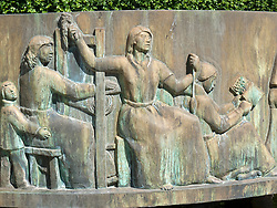 Detail of art on bronze fountain in central square in Boras Sweden