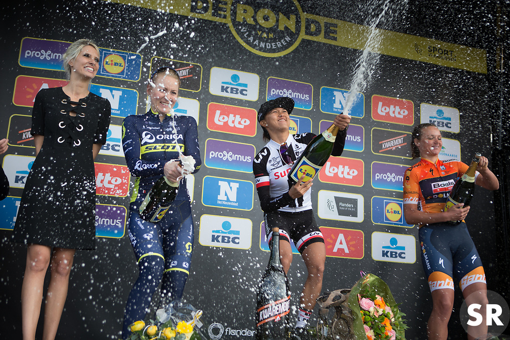 Coryn Rivera (USA) of Team Sunweb (m), Gracie Elvin (AUS) of Orica-AIS Cycling Team (l) and Chantal Blaak (NED) of Boels-Dolmans Cycling Team (r) celebrate on the podium of the Ronde Van Vlaanderen - a 153.2 km road race, starting and finishing in Oudenaarde on April 2, 2017, in East Flanders, Belgium.