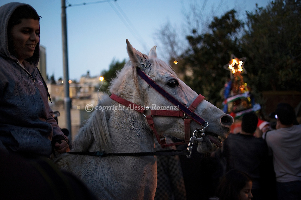 A Palestinian rides a horse in front of one of the disputed houses occupied by Israeli settlers in the Sheikh Jarrah neighborhood in East Jerusalem, December 23, 2009..© ALESSIO ROMENZI