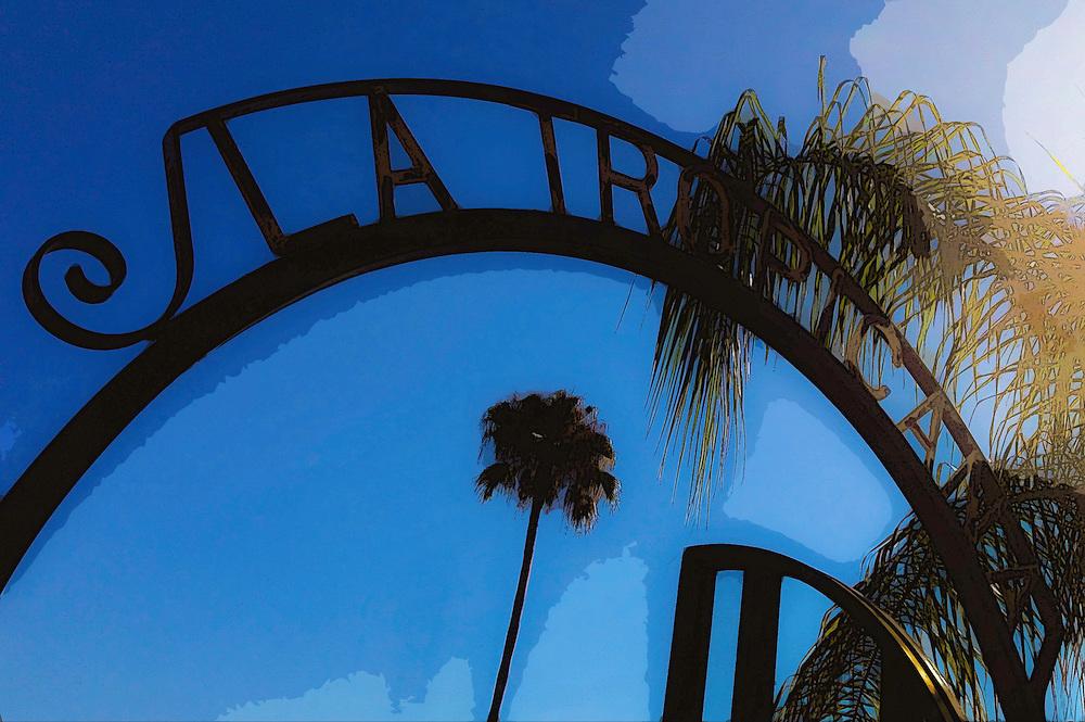 Iron gate outside La Tropicana, Ybor City (Tampa), Florida. Photo by Richard M. Porter