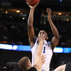 Mar 17, 2011; Tampa, FL, USA; Kentucky Wildcats guard Darius Miller (1) shoots over Princeton Tigers guard Dan Mavraides (33) during first half of the second round of the 2011 NCAA men's basketball tournament at the St. Pete Times Forum.  Mandatory Credit: Derick E. Hingle