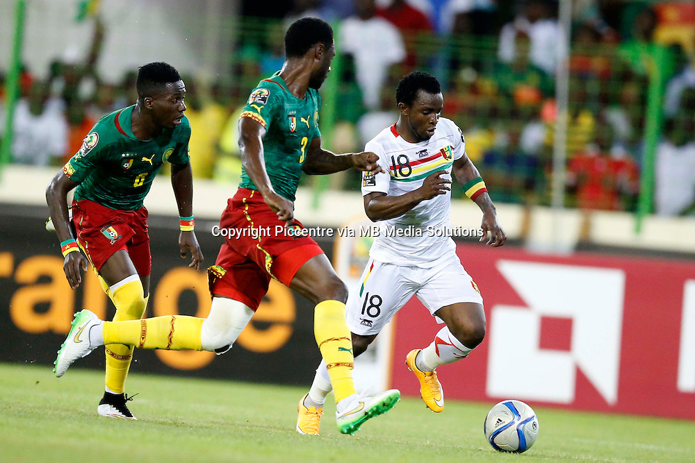 Seydouba soumah of Guinea outpaces Nicolas Loe of Cameroon during their AFCON match at the Nueva Estadio de Malabo on January 24, 2015.The match ended 1-1.Photo/Mohammed Amin/www.pic-centre.com (Equatorial Guinea)