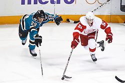 November 30, 2010; San Jose, CA, USA; Detroit Red Wings center Valtteri Filppula (51) skates past San Jose Sharks right wing Ryane Clowe (29) during the first period at HP Pavilion. Mandatory Credit: Jason O. Watson / US PRESSWIRE
