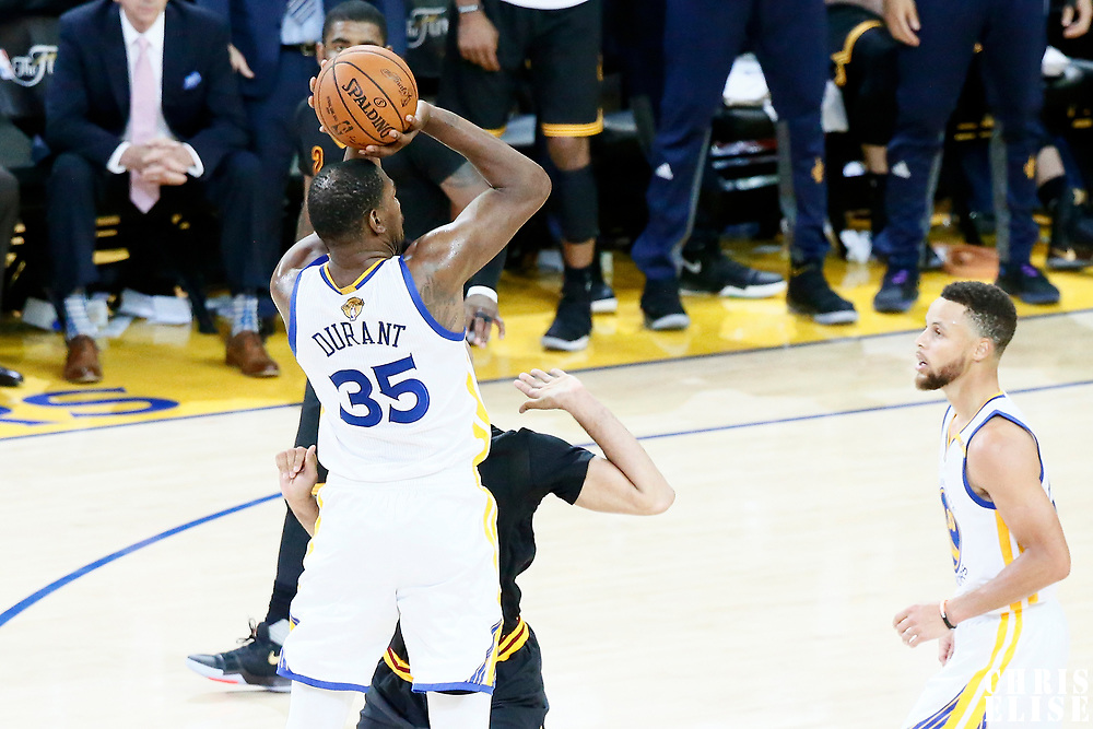 12 June 2017: Golden State Warriors forward Kevin Durant (35) takes a jump shot during the Golden State Warriors 129-120 victory over the Cleveland Cavaliers, in game 5 of the 2017 NBA Finals, at the Oracle Arena, Oakland, California, USA.