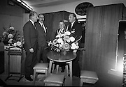 Irish Furniture Fair..1966..27.09.1966..09.27.1966..27th September 1966..Today saw the opening of the Irish Furniture Fair at the Intercontinental Hotel in Dublin. The fair is to promote the quality and value of furniture manufactured within Ireland...Picture shows Slaney Furniture representatives showing the Minister their range of furniture.