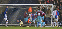Blackburn, England - Saturday, March 3, 2007: West Ham United's Carlos Tevez clears out the ball of the Blackburn Rovers' goal line, but the goal is given to West Ham United to give a 2-1 lead, during the Premiership match against Blackburn Rovers, at Ewood Park. (Pic by David Rawcliffe/Propaganda)