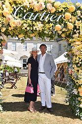 Carine Feniou and Laurent Feniou at the 'Cartier Style et Luxe' enclosure during the Goodwood Festival of Speed, Goodwood House, West Sussex, England. 15 July 2018.