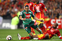 FOOTBALL - FRENCH CUP 2009/2010 - 1/4 FINAL - RC LENS v AS SAINT ETIENNE - 24/03/2010 - PHOTO ERIC BRETAGNON / DPPI - DIMITRI PAYET (ASSE) / ,ERIC CHELLE (LENS)
