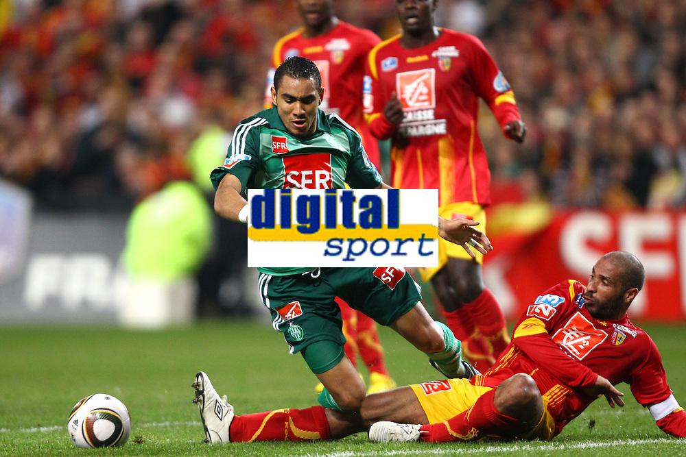 FOOTBALL - FRENCH CUP 2009/2010 - 1/4 FINAL - RC LENS v AS SAINT ETIENNE - 24/03/2010 - PHOTO ERIC BRETAGNON / DPPI - DIMITRI PAYET (ASSE) / ,ERIC CHELLE (LENS)