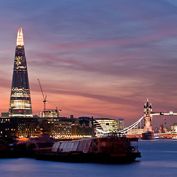 Sunset on the new London skyline with Tower Bridge and the new The Shard skyscraper. Long exposure.