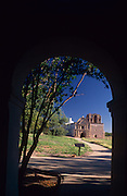 Tumacacori Mission viewed through arch in in visitor's center, Tumacacori National Historical Park, Tumacacori, Arizona...Rights & Usage:.No rights granted. Subject photograph(s) are copyrighted by ©1989 Edward McCain/McCain Photography. All rights are reserved except those specifically granted in writing prior to any use...McCain Photography.211 S 4th Avenue.Tucson, AZ 85701-2103.(520) 623-1998.mobile: (520) 990-0999.fax: (520) 623-1190.http://www.mccainphoto.com.edward@mccainphoto.com