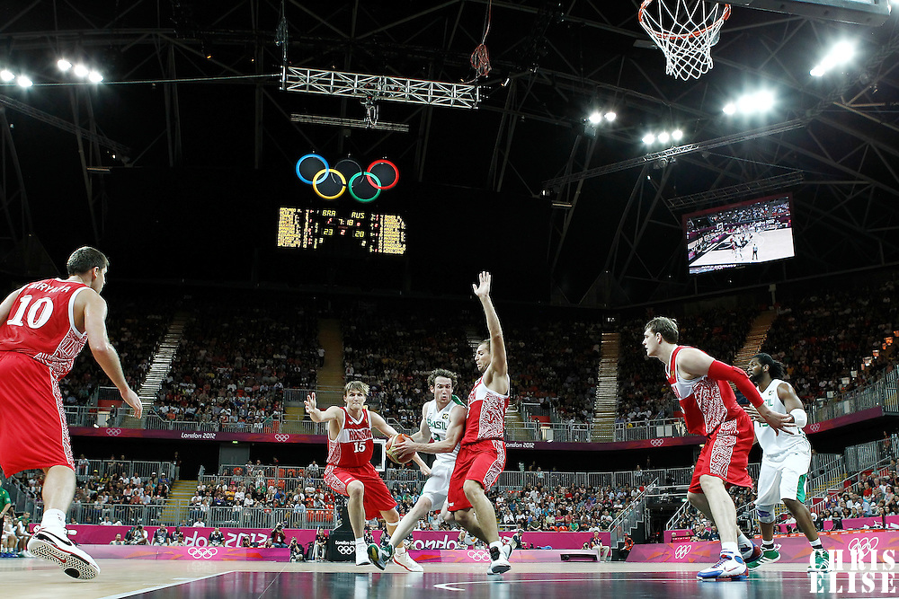 02 August 2012: Brazil Marcelinho Huertas drives past Russia Sergey Monya and Andrei Kirilenko during 75-74 Team Russia victory over Team Brazil, during the men's basketball preliminary, at the Basketball Arena, in London, Great Britain.