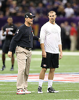 Alex Smith (11) of the San Francisco 49ers talks with head coach Jim Harbaugh against the Baltimore Ravens during the NFL Super Bowl XLVII football game in New Orleans on Feb. 3, 2013. The Ravens won the game, 34-31.  (Photo by Jed Jacobsohn)