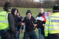 © under license to London News Pictures. 11/12/2010. Continuing their protests in towns and cities across the UK, the English Defence League protest against militant Islam in Peterborough. This EDL supporter spits as police try to push him away from the UAF protesters