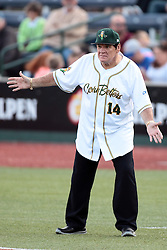 09 July 2015: Pete Rose know affectionately to fans as Charlie Hustle the current Major League Baseball all time hits leader acts as manager for the night in the first base coaches box shrugs his shoulders at an explanation of a call by field umpire Brad Swanson. Pete Rose night during a Frontier League Baseball game between the Schaumburg Boomers and the Normal CornBelters at Corn Crib Stadium on the campus of Heartland Community College in Normal Illinois