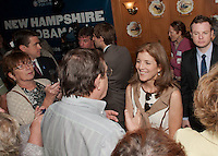 Caroline Kennedy chats with Joe Geoffrey along with dozens of supporters following her speech in support of President Obama at Hart's Turkey Farm in Meredith Thursday afternoon.  (Karen Bobotas/for the Laconia Daily Sun)