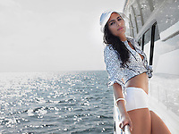 Young woman on yacht portrait